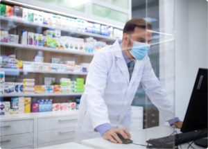 pharmacist looking up a prescription
